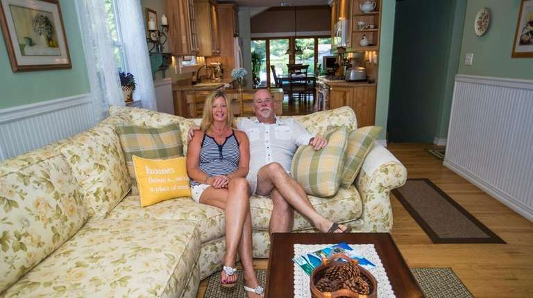 Tracy and John Martyn sit in the living