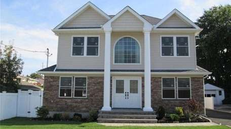 This Hicksville Colonial is considered high-end in Hicksville.