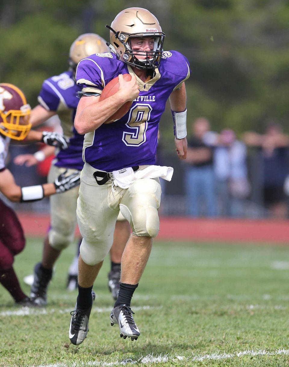 Sayville's Jack Coan runs for a touchdown against