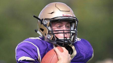 Sayville's Jack Coan runs for a touchdown in