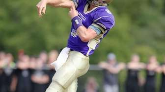 Sayville's Jack Coan throws a pass in the