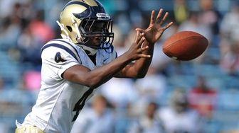 Baldwin quarterback Norm Wilson takes a snap against