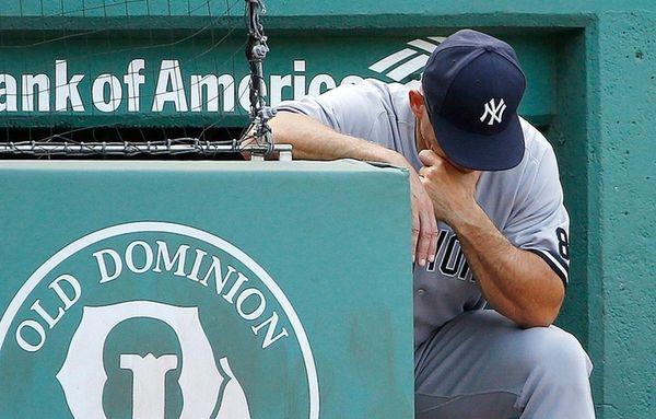New York Yankees manager Joe Girardi looks down