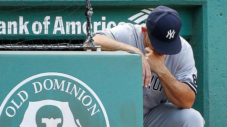 New York Yankees manager Joe Girardi looks down