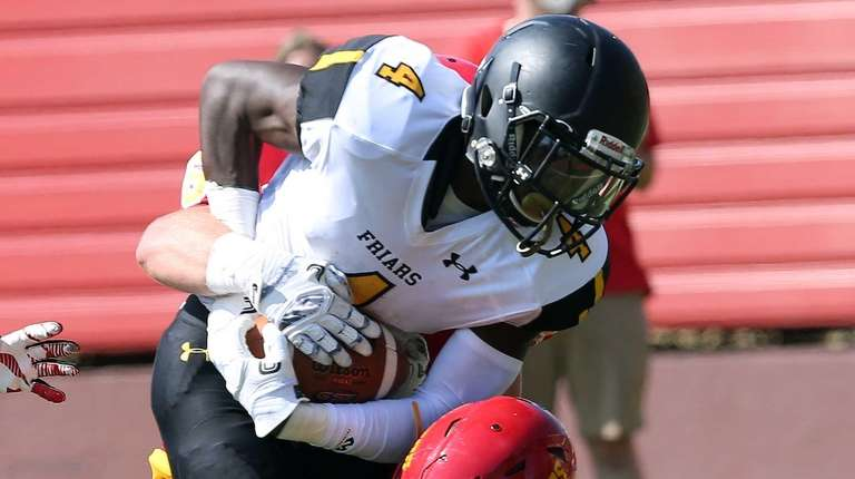 St. Anthony's Dion Williams gets hit during the