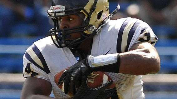 Jonathan Debique, who scored three touchdowns, picks up