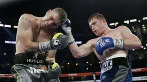 Canelo Alvarez, right, and Liam Smith, left, fight