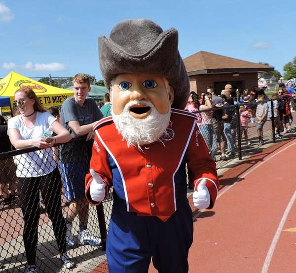 The MacArthur High School mascot gives a thumbs-up