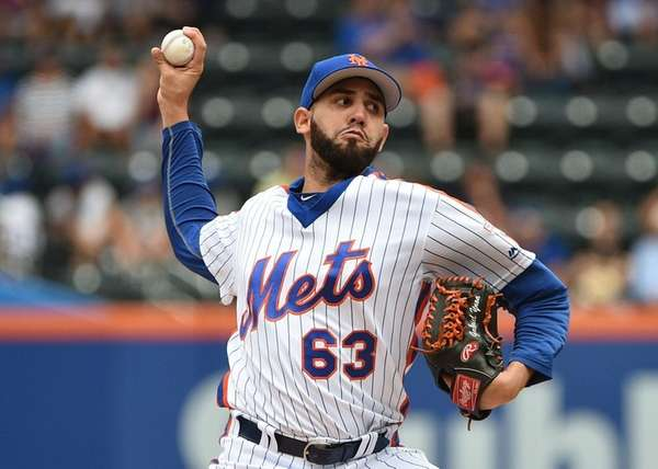 New York Mets starting pitcher Gabriel Ynoa delivers