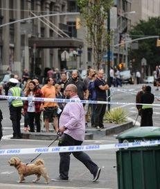 People walk outside of a barricaded zone following