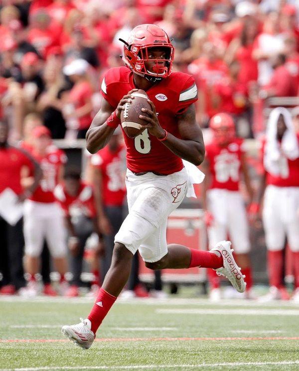 Lamar Jackson of the Louisville Cardinals runs with