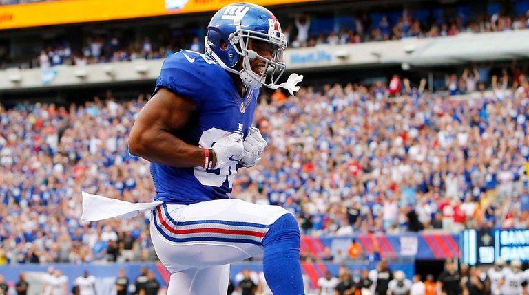Victor Cruz of the New York Giants celebrates