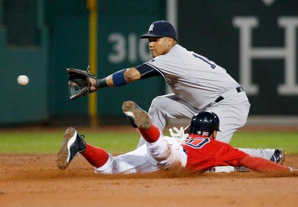 Boston Red Sox's Mookie Betts steals second base