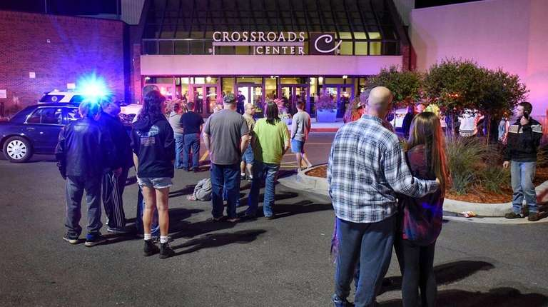 People stand outside the Crossroads Center shopping mall