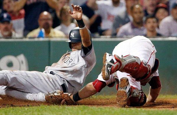 New York Yankees' Mason Williams, left, slides past