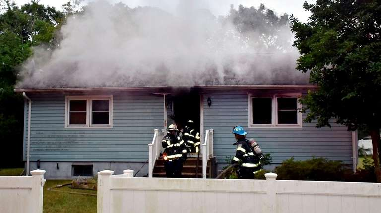 Firefighters at the scene of a fatal fire