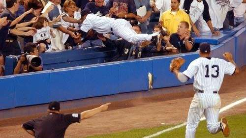 Derek Jeter leaps into the stands late in