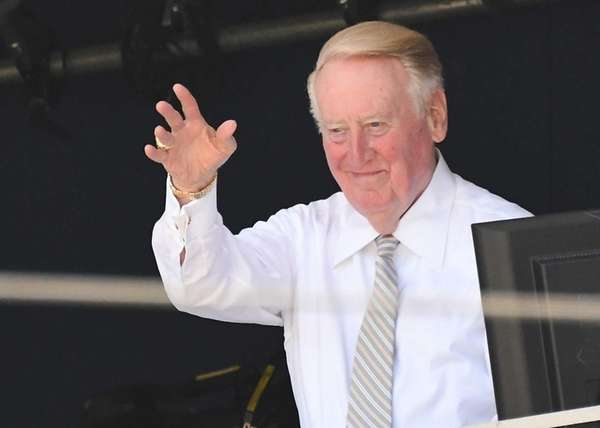 Los Angeles Dodgers broadcaster Vin Scully acknowledges the