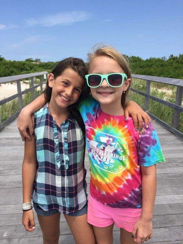 Cousins Gianna and Kali walking the pier at