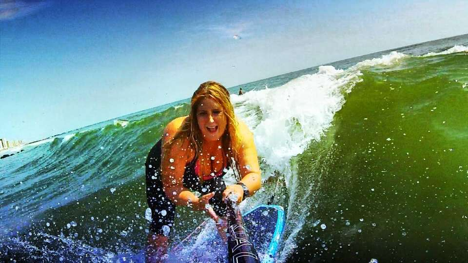 Nicole Glasser stand up paddle surfing the swell