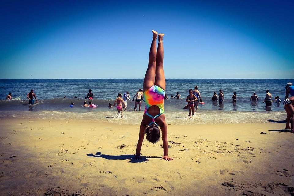 Addison Fiddle doing a handstand at Rehoboth Beach