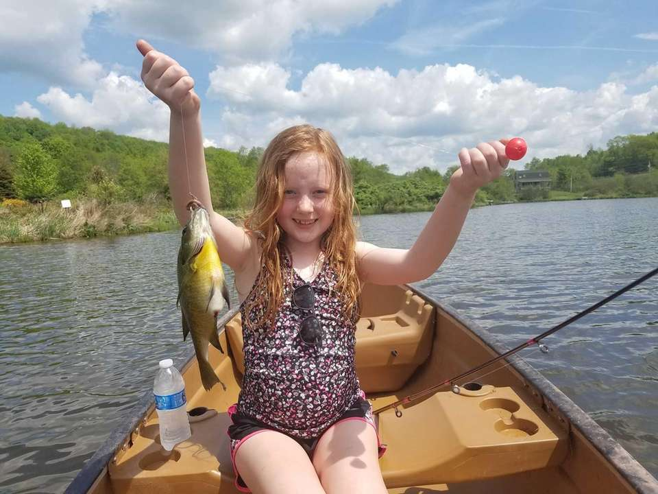 Peyton fishing at her uncle house in up