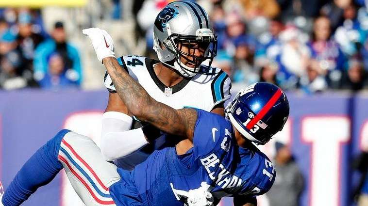 Josh Norman of the Carolina Panthers throws Odell