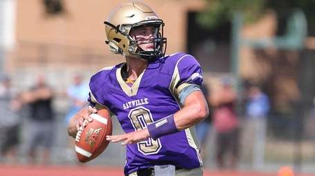Sayville's Jack Coan (9) gets ready to throw