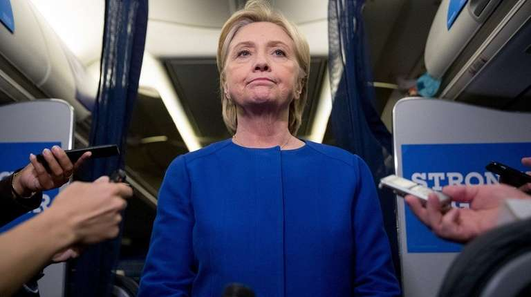 Hillary Clinton speaks to reporters about the bombing