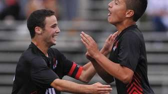 Sebastian Matos of Half Hollow Hills East, right,