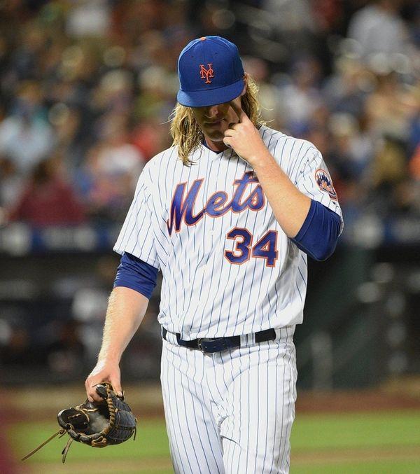 New York Mets starting pitcher Noah Syndergaard walks
