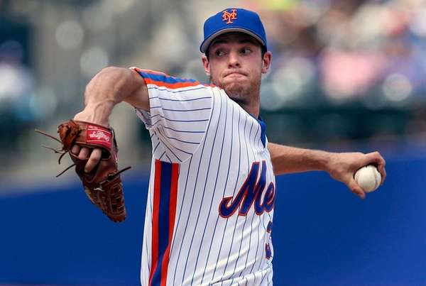 Mets starting pitcher Steven Matz throws during the