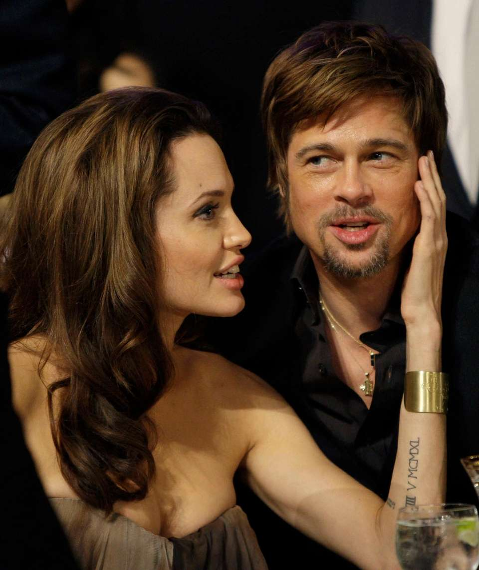 Angelina Jolie and Brad Pitt attend the 14th