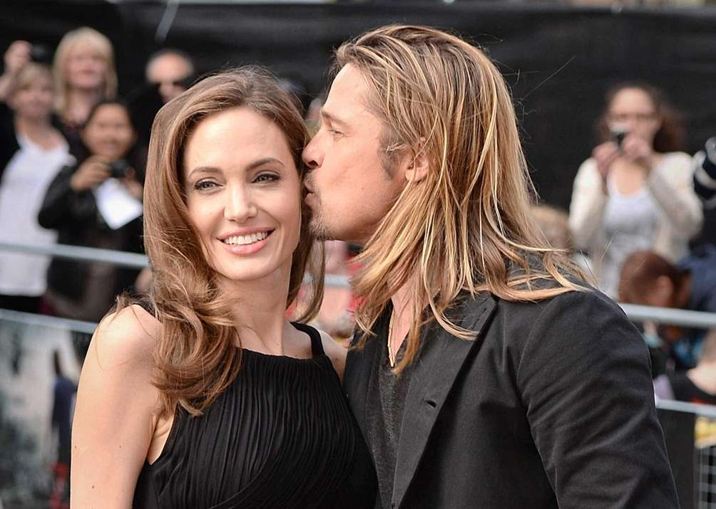 Angelina Jolie and Brad Pitt attend the world