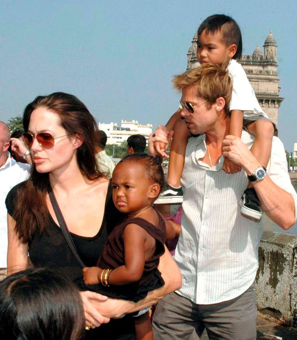 Angelina Jolie, with daughter Zahara, and Brad Pitt,