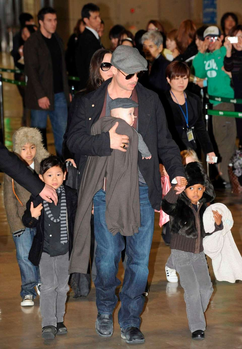Brad Pitt with his son Knox (in arms),