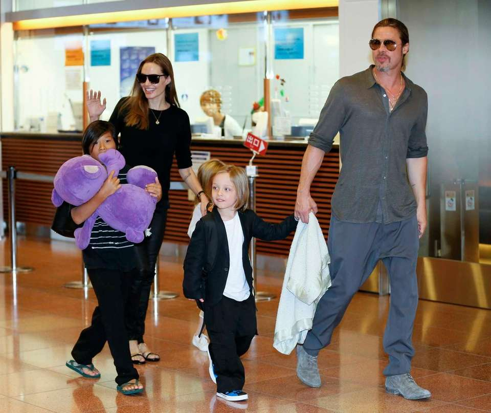 Angelina Jolie and Brad Pitt arrive with their