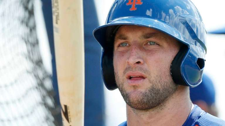Tim Tebow prepares for batting practice at the