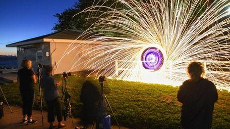 Eddie Giron, 40, of Levittown, creates a sparkling