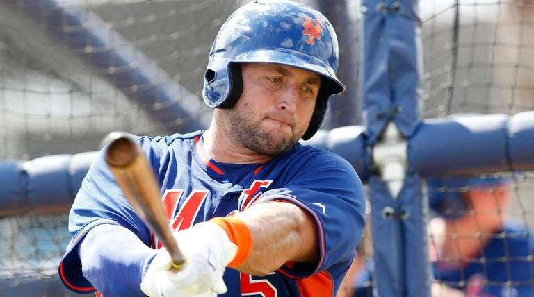Tim Tebow practices his swing during batting practice,