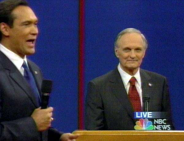 Jimmy Smits, left, debates Alan Alda on
