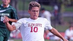 Glen Cove's Delwin Hernandez moves the ball downfield