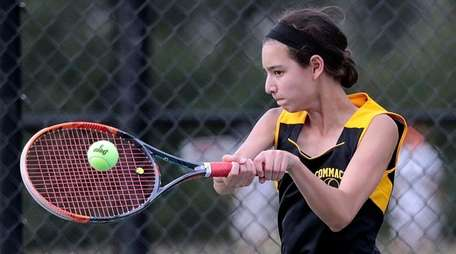 Commack's Emily Tannenbaum hits a backhand return during