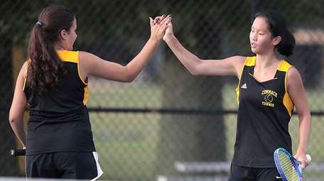 Commack's Andriana Kaimis and Kimberly Liao high five