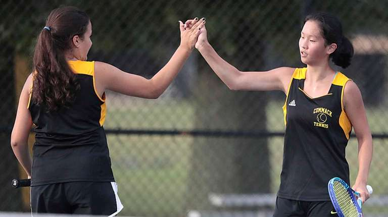 Commack's Andriana Kaimis and Kimberly Liao high five