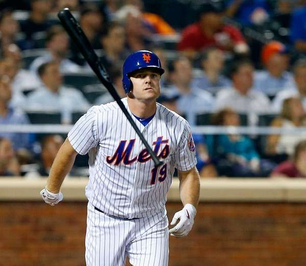 Jay Bruce reacts after flying out in the