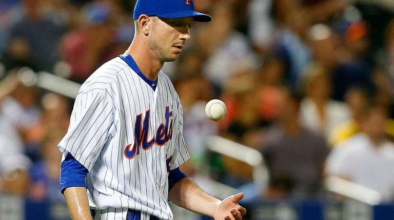 Jerry Blevins of the Mets reacts after surrendering