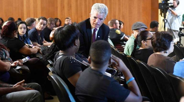 Suffolk County Executive Steve Bellone speaks with people
