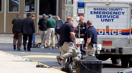 Nassau County police's Arson/Bomb Squad at the scene