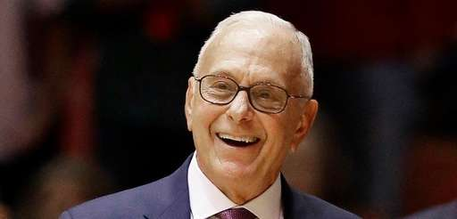 Southern Methodist coach Larry Brown signals his players